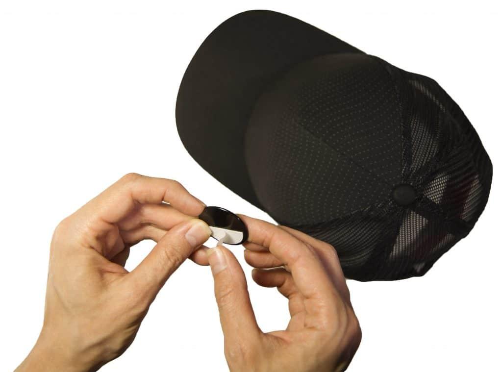 golf ball marker magnet in lining of a baseball cap