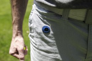 man wearing golf ball marker magnet in 5th pocket with blue ball marker